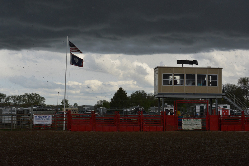 Spectators and competitors find cover during a brief but violent hailstorm during the Sheridan High School rodeo over Memorial Day weekend. (Brad Estes)