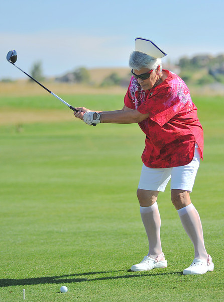 "Jane Vofaw with team Nurses Call the Shots drives on Eagle 1 at the Powder Horn golf course Saturday during the ""Drive for the Cause"" golf tournament. The fundraiser is to benefit the Sheridan Memorial Hospital Cardiac Catheterization Center and Women's Heart Health. All teams were judged by their name and decorations in theme of heart health."
