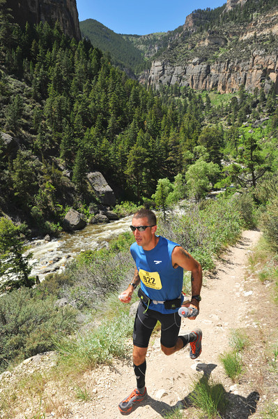 Tim Cahhal sprints down the path in the 50 Mile race during the Bighorn Mountain Wild and Scenic Trail Run Saturday in Tongue River Canyon.