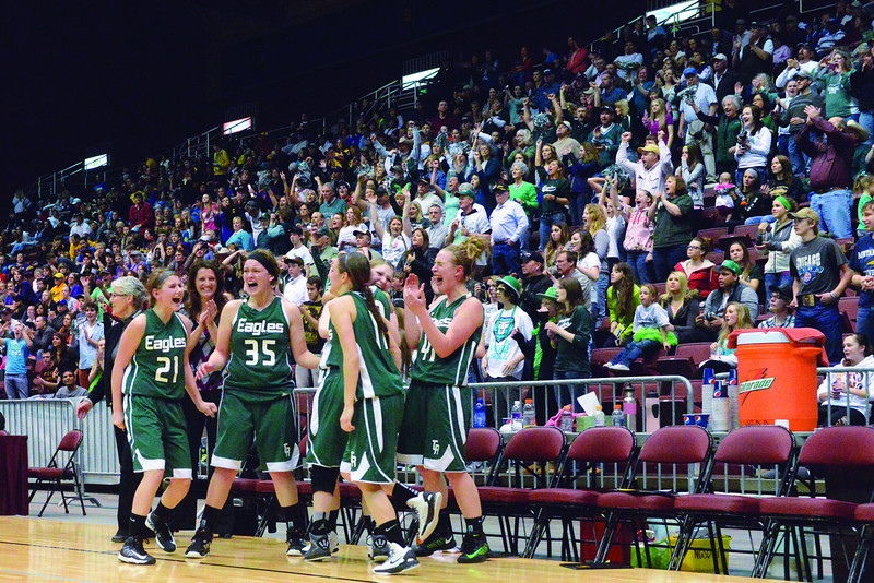 Lady Eagles players react as time expires on their 2A state championship this March in Casper. (Brad Estes)