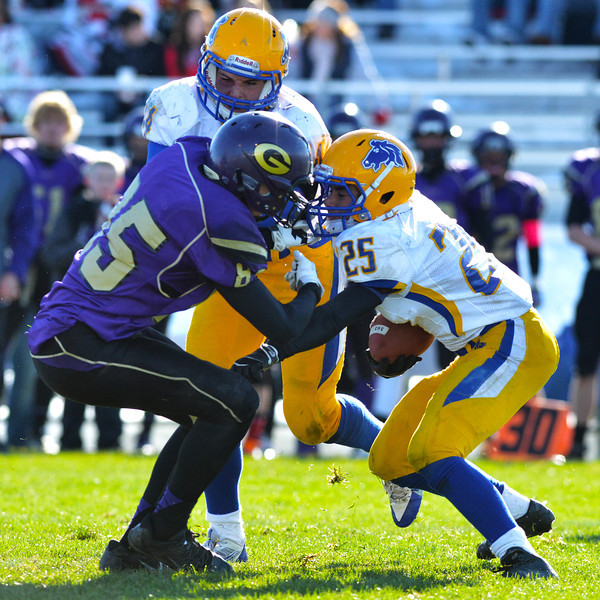 Evan Coon battles for yardage with help from Dan Sessions in the second half of the Broncs 39-10 Energy Bowl loss Saturday in Gillette. (Brad Estes/The Sheridan Press)