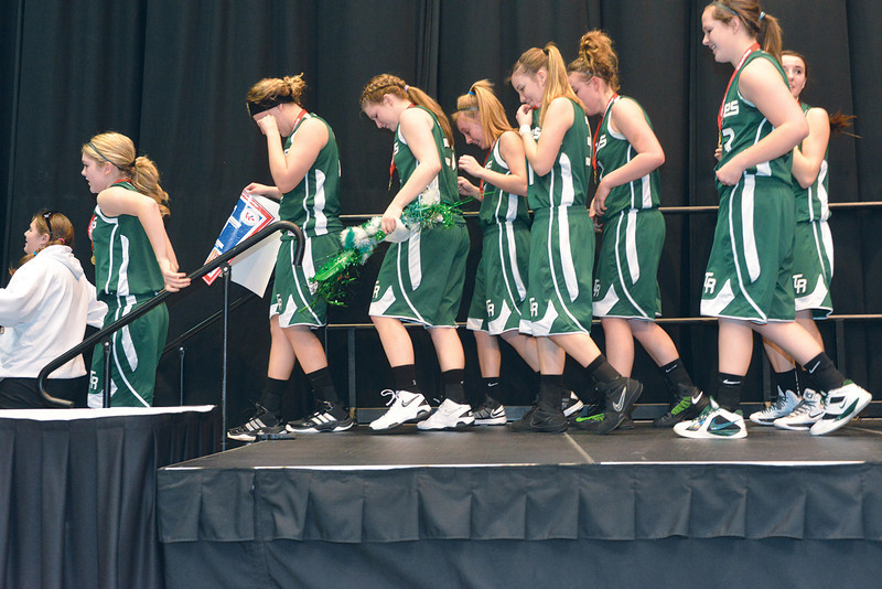 The Tongue River Lady Eagles walk down off the podium after receiving their 2A Girls State Championship trophy Saturday, March 2, 2013 at the Casper Events Center. (Brad Estes)