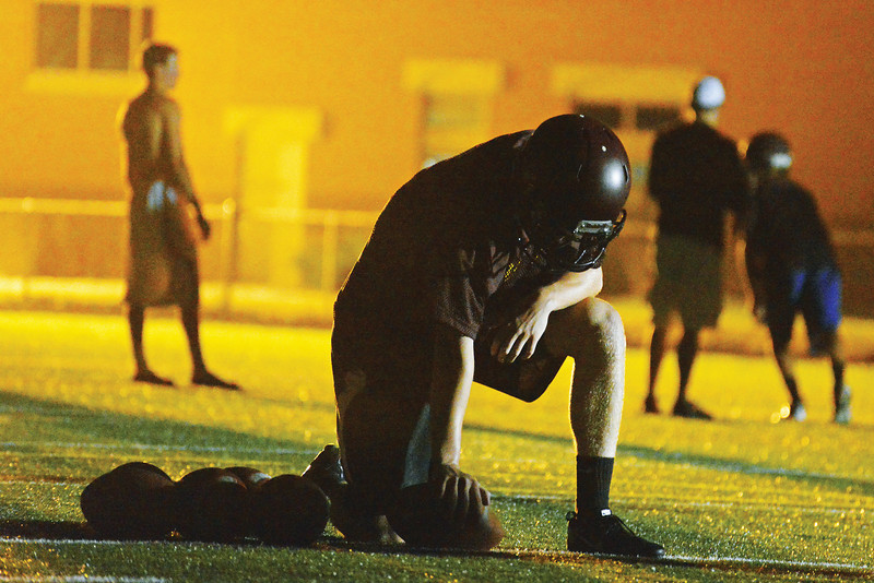 Connor McCafferty rests between reps during the Rams Midnight Mayhem practice kick off in August. (Brad Estes)
