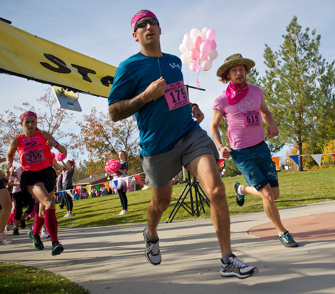 "Runners take off from the starting line during the ""The Link – Partners in Pink"" fundraiser at Whitney Commons on Saturday. From left, Marianne Foster, Tim Cahhal, and Andrew Hall. Foster took first in the 5K overall with Hall in second. Cahhal won the 10K overall."