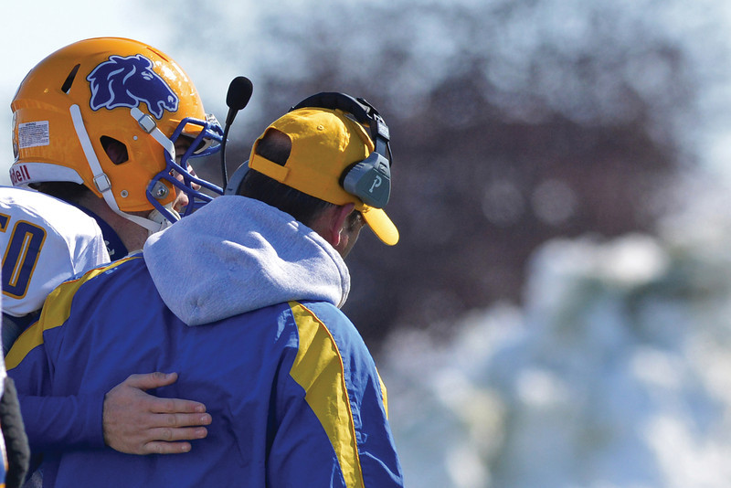 Senior lineman Tyler Julian embraces his dad, Broncs head coach Don Julian, after the Broncs went up 7-0 during the first quarter of their 39-10 loss in the Energy Bowl Saturday afternoon in Gillette. (Brad Estes/The Sheridan Press)