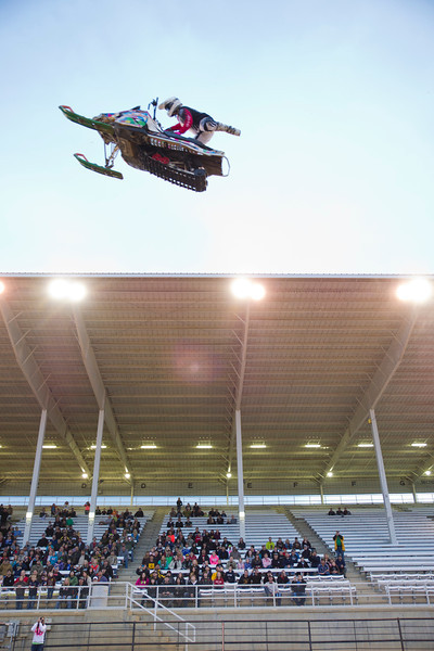 Travis Cady executes the Seat Grab Indian Air in front of the grandstands at the Fairgrounds arena on Saturday during the Snowmobile Spectacular by Octane Addictions.