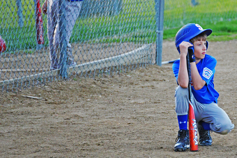 Garret Custis waits on deck during a Little League game at Sheridan College in June. (Brad Estes)