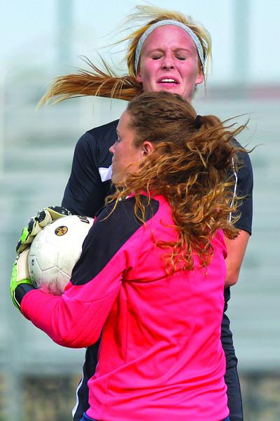 Lynette Nygard collides with the goalkeeper in the first half during the Lady Generals 1-0 loss to Western Nebraska Community College Monday afternoon in Sheridan. (Brad Estes/The Sheridan Press)