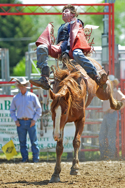 Chance Ames of Worland loses his hat during the annual Sheridan High School rodeo over Memorial Day Weekend at the Sheridan County Fairgrounds. (Brad Estes)