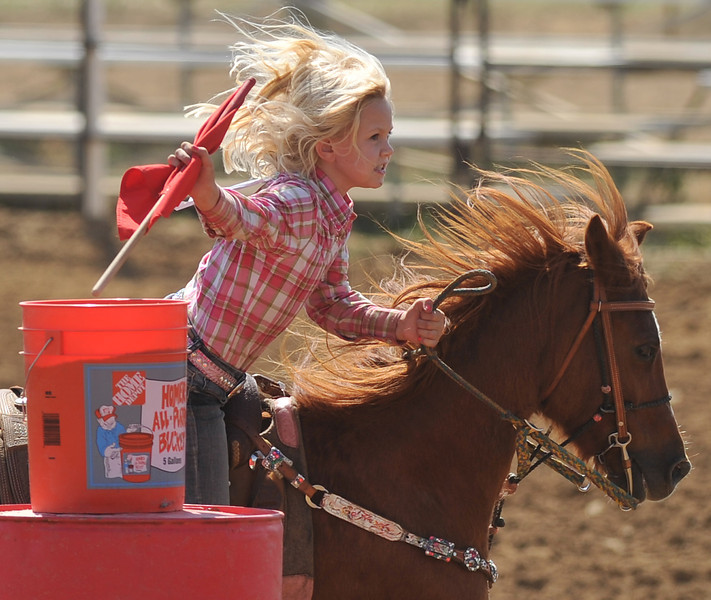 Landry Haugen picks up the flag as she competes in the Junior Flag Race during the Elks Youth Rodeo Saturday afternoon at the Sheridan County Fairgrounds.