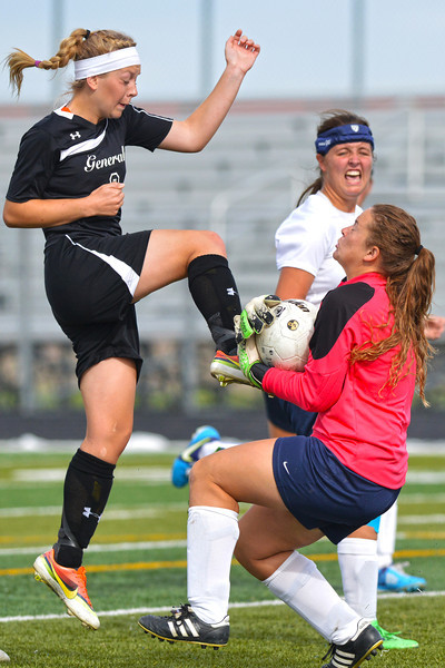 Macy Reid gets her foot on a ball as the goalkeeper gathers it in during the Lady Generals 1-0 loss to Western Nebraska Community College Monday afternoon in Sheridan. (Brad Estes/The Sheridan Press)
