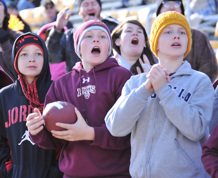 Big Horn fans Kade Eisele, left, Quinn McCafferty, and Will Pelissier react to the Rams State game Friday at the War Memorial Stadium. (The Sheridan Press/Justin Sheely)