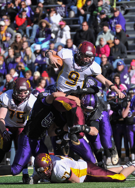 Senior quarterback Connor McCafferty jumps over a pile of defenders during the second quarter Friday in Laramie. (The Sheridan Press/Justin Sheely)