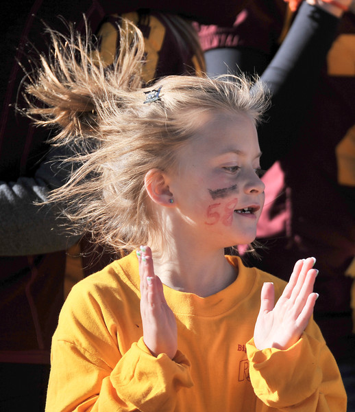 7-year-old Josie Lube celebrates during the Big Horn Rams 2A State championship Friday at the War Memorial Stadium in Laramie. (The Sheridan Press/Justin Sheely)