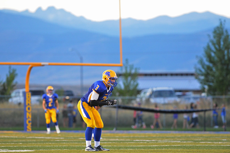Tyler Kaufmann sets up for a punt return in front of Joe Shassetz (2) Friday night during the first half.