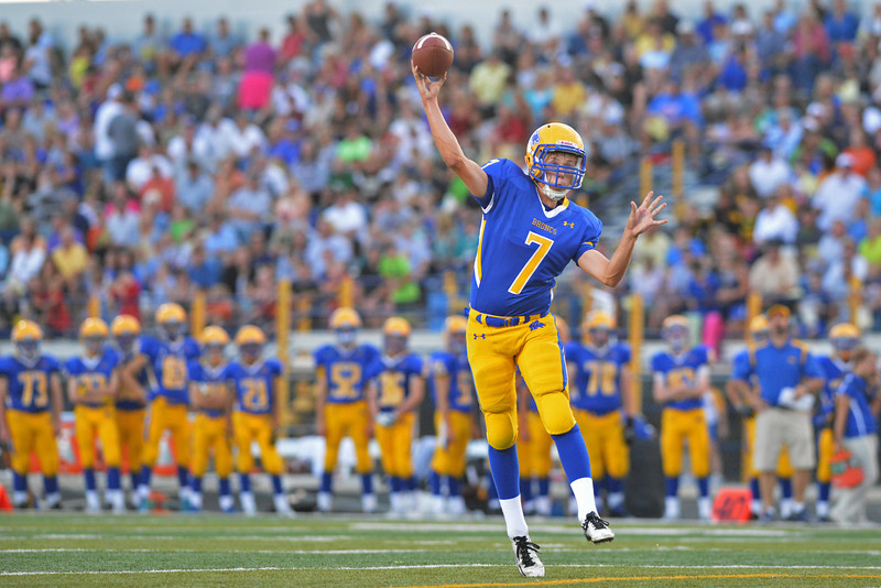 Bronc QB Kameron Eckard rolls out for a pass in the first quarter. He would find Tyler Kaufmann in the end zone to make the score 7-0.