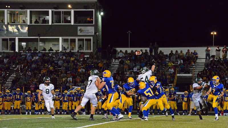 Bronc quarterback Kameron Eckard fires a pass late in Friday's 26-10 win over Kelly Walsh at Scott Field.