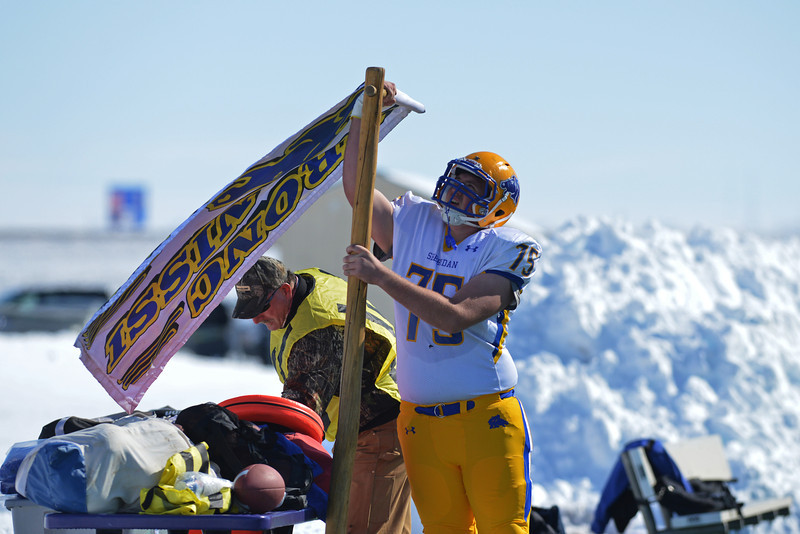 Justin Orum secures the Broncs flag on thier sidelines prior to Sheridan's 39-10 loss in the Energy Bowl Saturday afternoon in Gillette. (Brad Estes/The Sheridan Press)