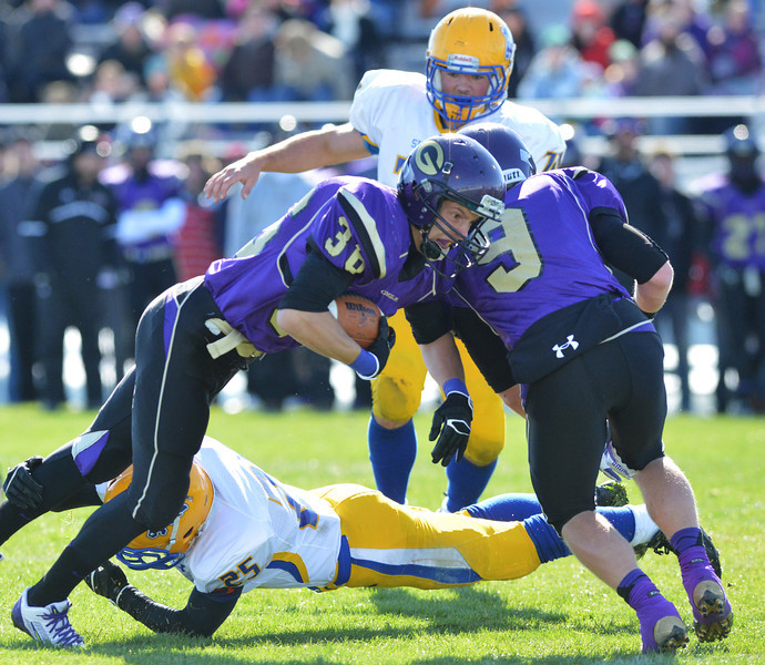 Evan Coon brings down Gillette's Billy Williams during the first quarter of the Broncs 39-10 Energy Bowl loss Saturday in Gillette. (Brad Estes/The Sheridan Press)