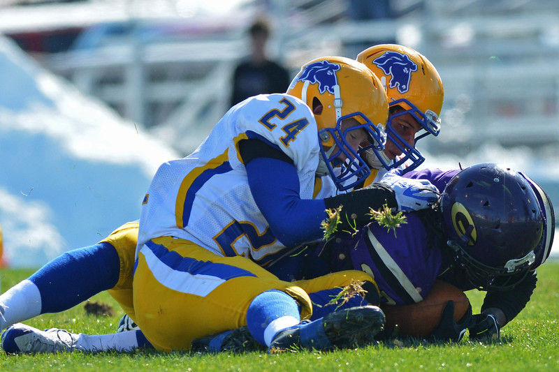 Colbey Bruney and Dan Sessions bring down Gillette runner Tichun Aippersach during the first quarter of the Broncs 39-10 Energy Bowl loss Saturday in Gillette. (Brad Estes/The Sheridan Press)
