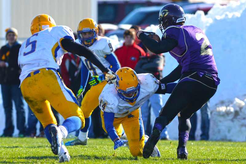 Austin Fort evades a tackle from Dan Sessions during the third quarter of the Broncs 39-10 Energy Bowl loss Saturday in Gillette. (Brad Estes/The Sheridan Press)
