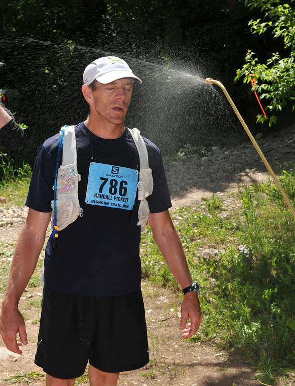 Randall Pickett gets doused with cool water during the Bighorn Mountain Wild and Scenic Trail Run Saturday at the checkpoint at the Tongue River Canyon trailhead.