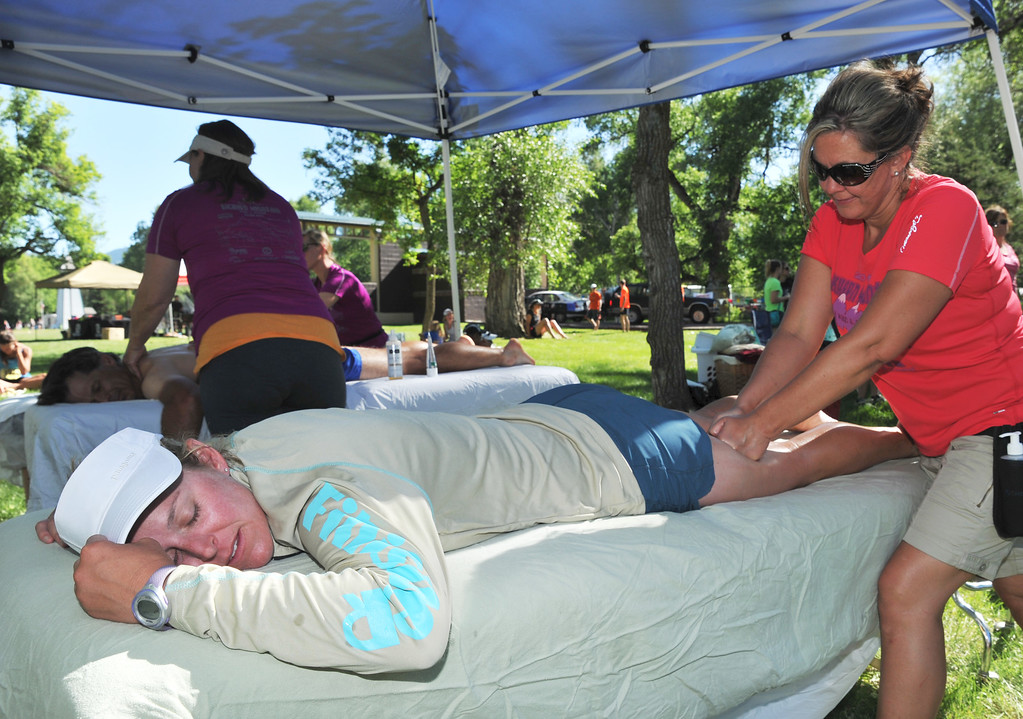 Stacey Grohne, from Jackson, Wyo., receives a massage from Lisa Brunkhardt after a long run Saturday at Scott Bicentennial Park in Dayton. Grohne had completed the 50K race in the Bighorn Mountain Wild and Scenic Trail Run.