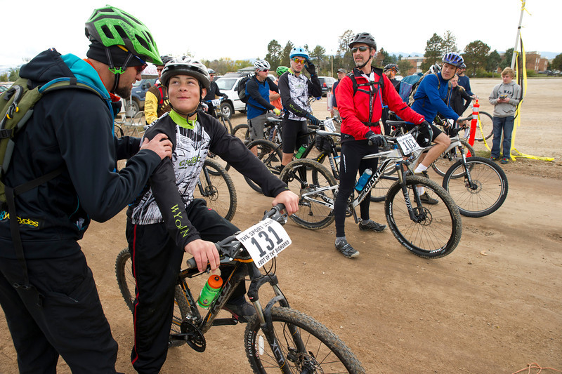 Leif Hohansson, left, gives Cameron O'Malley a pat on the back at the staring line of the 25-mile bike race during the Biketober Fest at the Sheridan County Fairgrounds on Saturday.