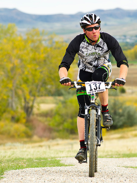 Scott Gavin pushes his way up a hill on the Soldier Ridge Trail in the 25-mile mountain bike race during the Biketober Fest fundraiser on Saturday.