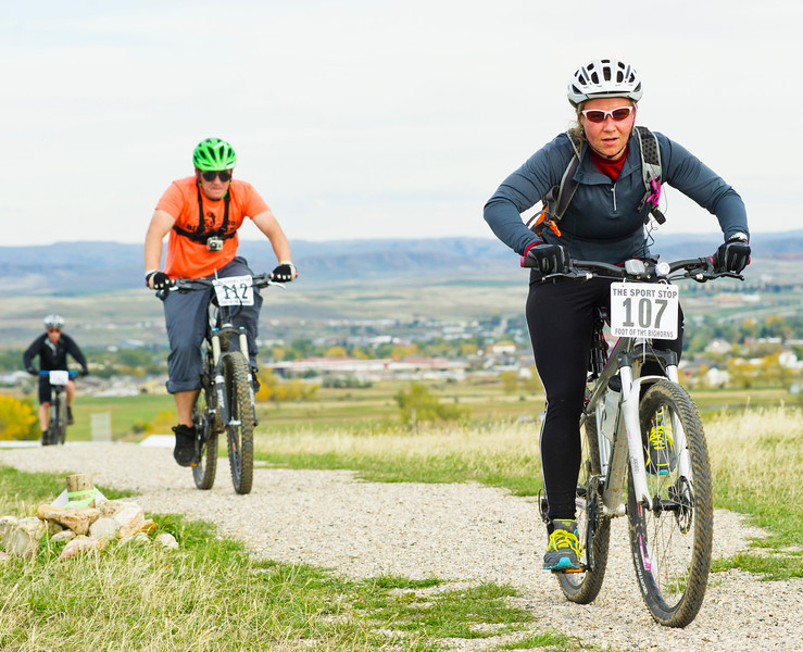 Eric Barkan, left, follows Melissa Marsh on Soldier Creek Trail in the 25-mile mountain bike race during the Biketober Fest fundraiser on Saturday. The fundraising event was to benefit the Sheridan County Land Trust which made projects like the Soldier Ridge Trail possible.