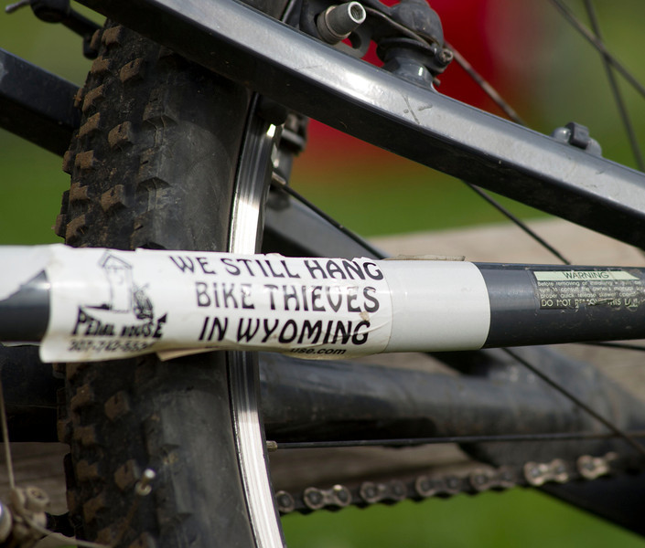 A bumper sticker is seen on a contestant's bike during the Biketober Fest race at the Sheridan County Fairgrounds on Saturday.