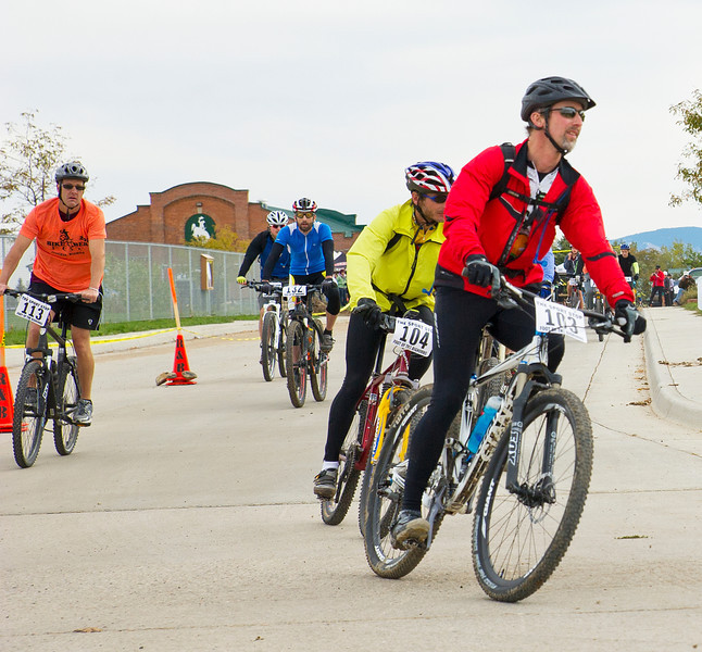 Christopher Reilly, right, and a group of participants exit the Sheridan County Fairgrounds at start of the 25-mile bike race for the Biketober Fest on Saturday.