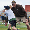University of Wyoming co-offensive coordinator/offensive line coach Jim Harding works with campers Monday afternoon on Homer Scott Field at Sheridan High School.