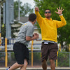 Sheridan-native Sartaj Khan, UW football administrative graduate assistant, tosses a pass during a playaction-fake drill with running backs at UW football camp Monday afternoon.