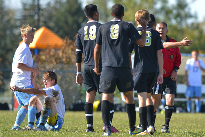 Kalob Rodriguez is helped up by Aaron Gann after Rodriguez earned a late free kick, driving near the Northeastern JC penalty box in extra time. The Generals would attack the rebounding free kick as time expired, but fall just short in a 2-1 loss Wednesday at Maier Field. (The Sheridan Press/Brad Estes)