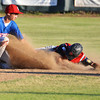 Second baseman Tyler Stauffer applies a tag as a Casper runner slides safely on steal at second Thursday night at Thorne-Rider.