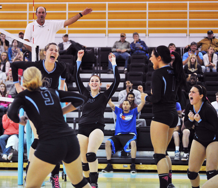 Lady Generals celebrate a crucial point in the fifth set against Casper College which gave them a break from the neck-and-neck scoring in the Golden Dome at Sheridan College on Thursday.