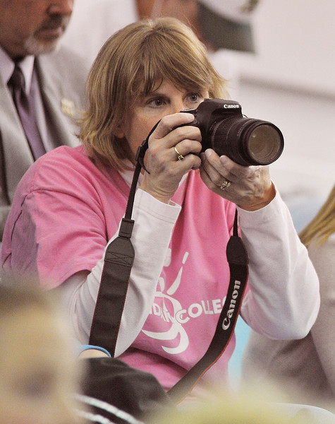 Lady Generals host mom Amy Martini shows her support as she photographs the game on Thursday at the Sheridan College Golden Dome.