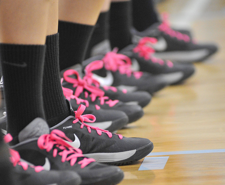 Lady Generals players wear pint shoe laces in support of the fight against Breast Cancer during the 'Pack the Place in Pink' volleyball game against Casper College at the Golden Dome on Thursday.