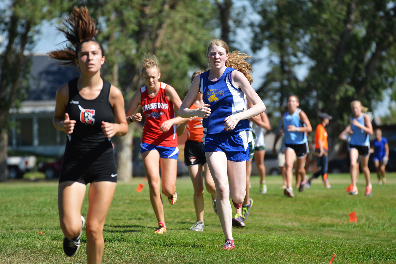 Lady Bronc Zoe Sherman, center, runs midway through the varsity girls race during the Michelle Ludwig Invite Saturday.