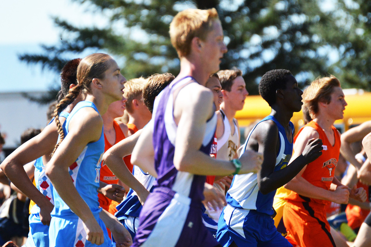 Sheridan runner Micah Sweeney moves with the pack as the boys varsity race begins at the Michelle Ludwig Invite Saturday.