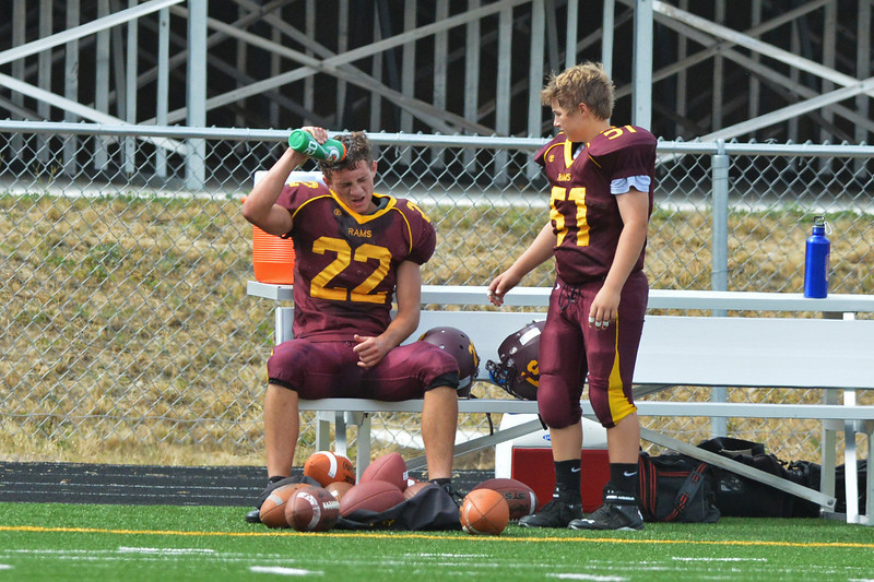 Colter Carzoli tries to cool down on the sidelines during the second half with some help from Jeremy Wolfe.