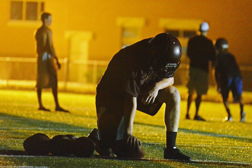 Senior quarterback Connor McCafferty takes a break between reps in running back drills during Big Horn Rams football practice early Monday morning. (Brad Estes/The Sheridan Press)