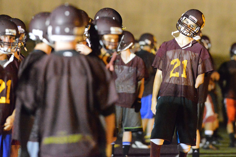 MIchael Lamb waits in warm-up lines Monday morning at Dow Memorial field during a Midnight Mayhem event held as the first Big Horn Rams football practice of 2013. (Brad Estes/The Sheridan Press)