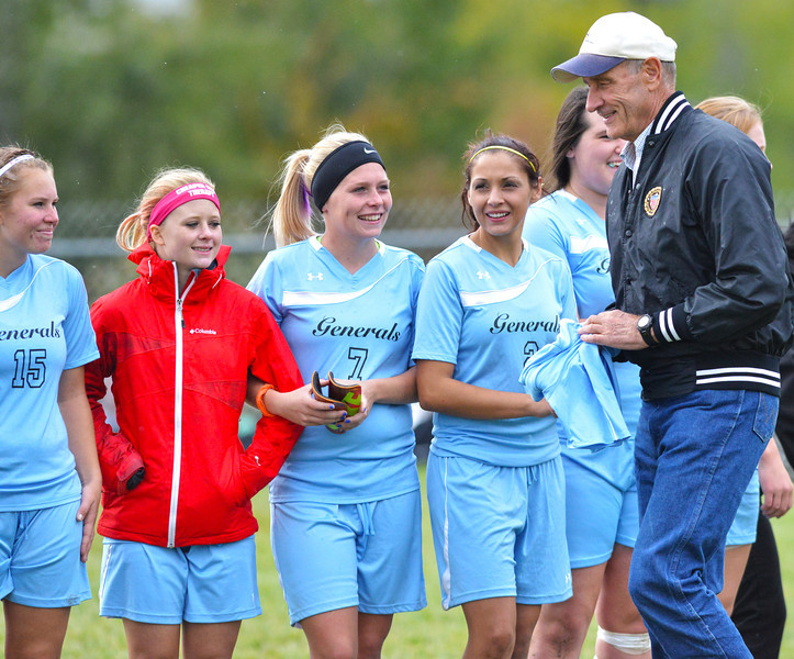 Lady Generals soccer players give Steve Maier his honorary jersey after their loss to Northwest College Wednesay afternoon at Maier Field. (Brad Estes/The Sheridan Press)
