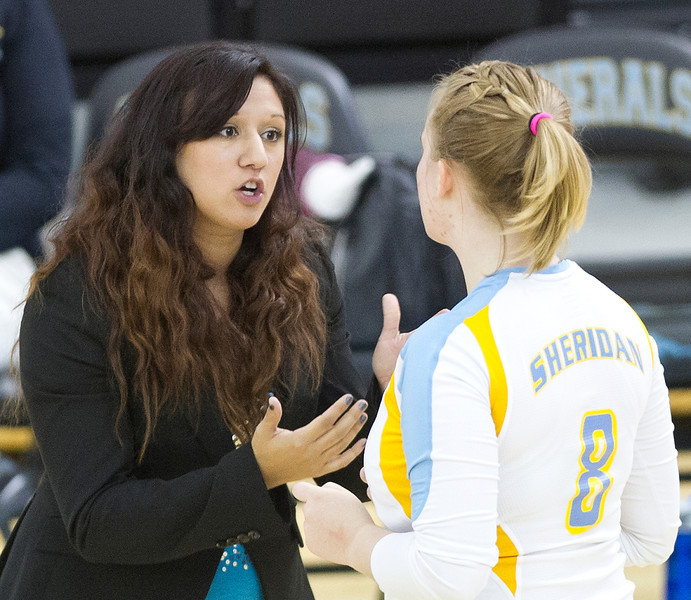 Generals volleyball coach Jennifer Stadler gives a pep talk to Jenna Jordan during a match against Northwest Friday night at the Sheridan College Golden Dome. Sheridan lost all three sets. (Justin Sheely/The Sheridan Press)