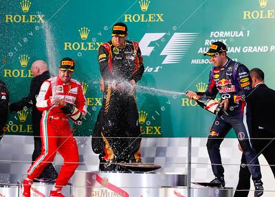 2013 Australian F1 GP - Kimi Raikkonen, Fernando Alonso and Sebastian Vettel celebrate on podium