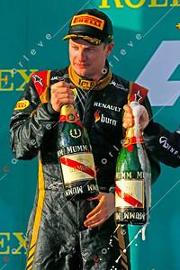 2013 Australian F1 GP - Kimi Raikkonen celebrates on the podium