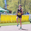 Record-Eagle/Keith King<br /> Kelly Gries finishes first in the women's marathon Saturday, May 25, 2013 during the 31st annual Bayshore Marathon.