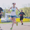 Record-Eagle/Keith King<br /> Caitlin Smith finishes first in the women's half marathon Saturday, May 25, 2013 during the 31st annual Bayshore running races.